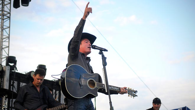 Country singer Clay Walker sings to the crowd at the beginning of his set during the 2015 FireFest music festival.
