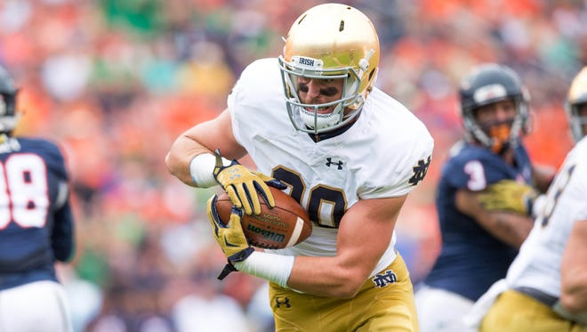 Notre Dame Fighting Irish tight end Durham Smythe (80) runs for a touchdown on a fake field goal in the first quarter against the Virginia Cavaliers at Scott Stadium.