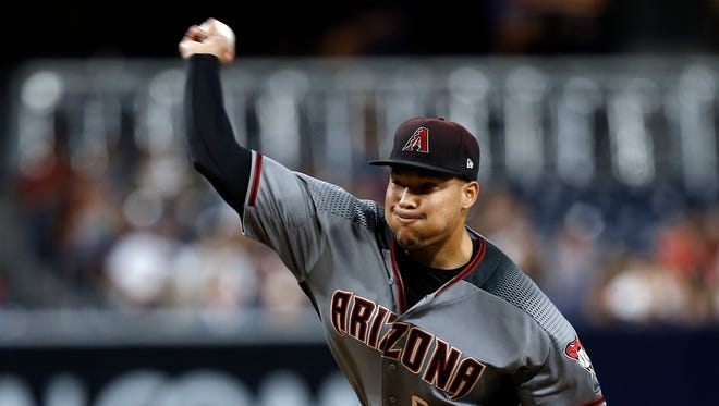 Arizona Diamondbacks starting pitcher Taijuan Walker throws to a San Diego Padres batter during the first inning of a baseball game in San Diego, Friday, May 19, 2017.
