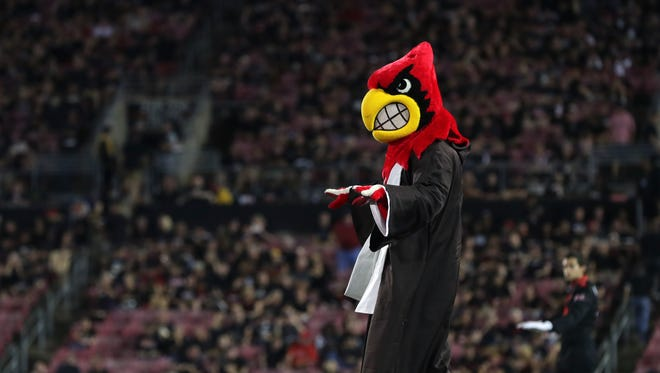 Jedi Louie directs the U of L Marching Band during the halftime show at the Louisville versus Clemson game.