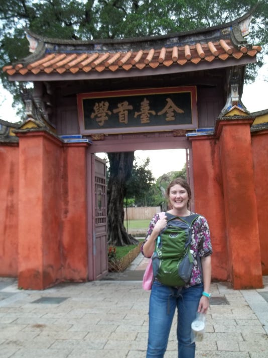 Lillian Fitzpatrick standing in front of the gate to the courtyard of the Ta.jpg