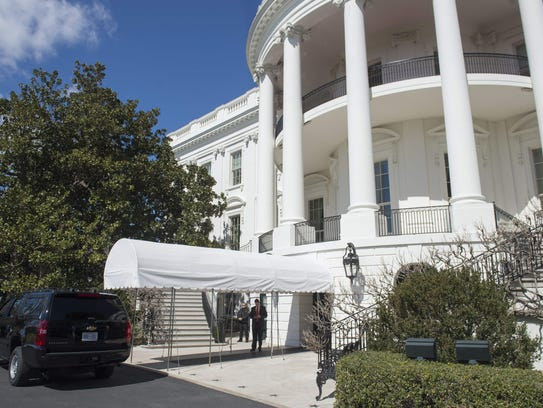 A SUV is parked outside of the South Portico on the