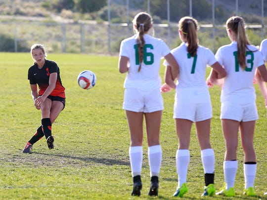 Aztec's Grace Olsen takes a free kick during a game against Los Alamos Lady  on Saturday at the Aztec Tiger Sports Complex.
