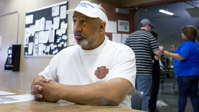 Air Force veteran Luis Hernandez receives assistance at Central Arizona Shelter Services in Phoenix on Thursday.