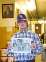 "Huey P. ""Sleepy"" Roberts, 86, holds a copy of a photo"