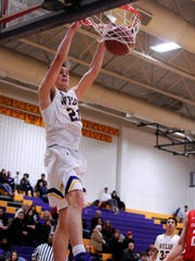 Wylie's Dylan Isenhower (21) holds onto the rim after