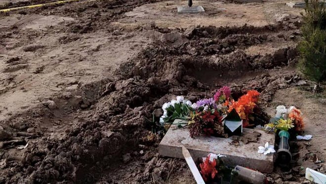 Tractors digging a new grave at Our Lady of Mount Carmel Cemetery this weekend left ruts on the ground that had been wet and softened by the recent rain and snow, the Catholic Diocese of El Paso said. The cemetery was not vandalized as a social media post indicated, officials said.