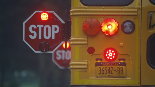 Motorists should watch out for school buses and stop when they see yellow or red lights.