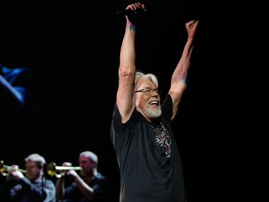 Bob Seger raises his hands in celebration with the