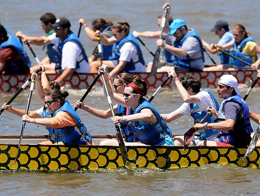 Paddlers compete at the first annual Dragon Boat Races and Festival in Poughkeepsie on the Hudson River.   Follow me at @DBatPoJo