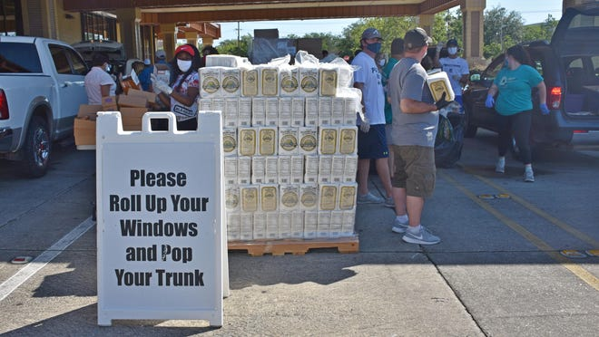 Hundreds of residents received free food during a drive-through emergency distribution in May at the Houma-Terrebonne Civic Center. Another is scheduled Friday.