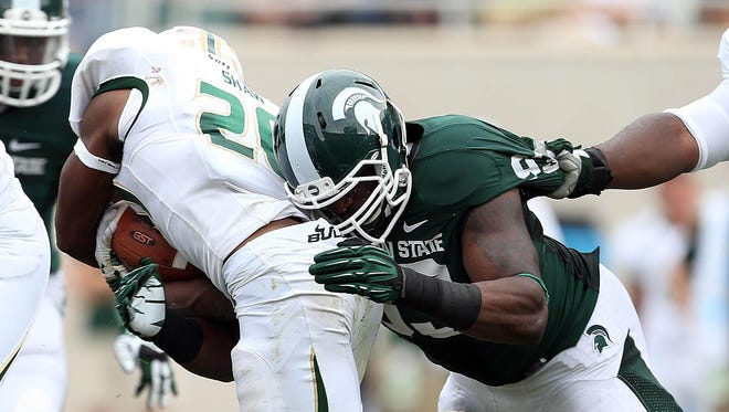 MSU's Damon Knox tackles South Florida running back Marcus Shaw (20) during the first half of their game in 2013.