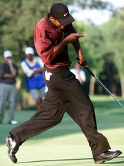 Tiger Woods coaxes his putt in on the 16th green during a playoff at the 2000 PGA Championship at Valhalla.