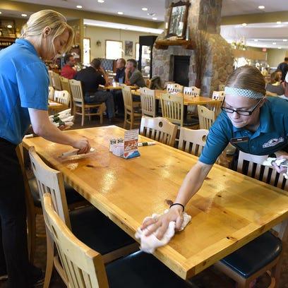 Steve Danzl, owner of the Cornerstone Buffet & Restaurant, handles the cash register during lunch Thursday in Melrose.