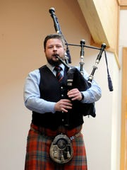 Dan Nevans, of Scotland, plays the pipes on Sunday at Firelands Presbyterian Church as part of the Port Clinton Musical Arts Series. Nevans and his best friend Andrew Bova, originally of Perrysburg, play together in the Shotts and Dykehead Caledonia Pipe Band.