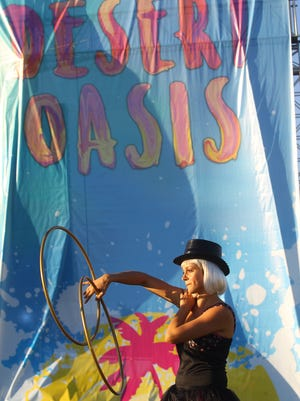 Performance artists are shown during the Desert Oasis Music Festival held at the Empire Polo Club in Indio on October 7, 2017.