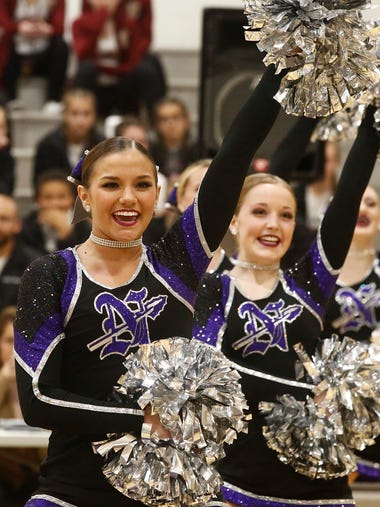 The Norwalk High School dance team performs a pom routine.