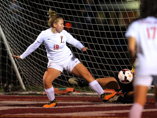 Loveland striker Caroline Florea can't get this shot
