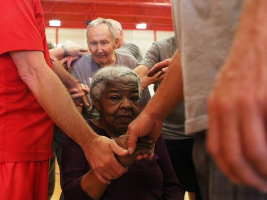 Clarice Chatmon clasps hands with other members of Rock Steady Boxing, a fitness organization that uses boxing to help Parkinson's patients maintain mobility, after they do circuit training in the basketball gym in the Lambright Sports and Wellness Center at Louisiana Tech University in Ruston, Thursday, April 13, 2017. Chatmon as been with the program since it started in October but recently had a stroke. Thursday was her first day back after the stroke.