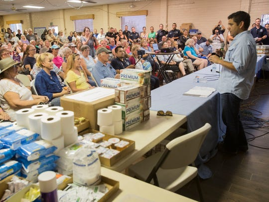 At right, U.S. Congressman Dr. Raul Ruiz speaks at a community meeting at the Anza Community Center on the developments of the Cranston Fire on July 31, 2018.