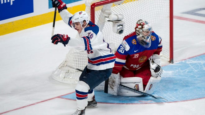 United States' Troy Terry celebrates after scoring past Russia goaltender Ilya Samsonov in the shootout to beat Russia 4-3 in a semifinal game at the World Junior ice hockey championships, Wednesday, Jan. 4, 2017 in Montreal. (Paul Chiasson/The Canadian Press via AP)