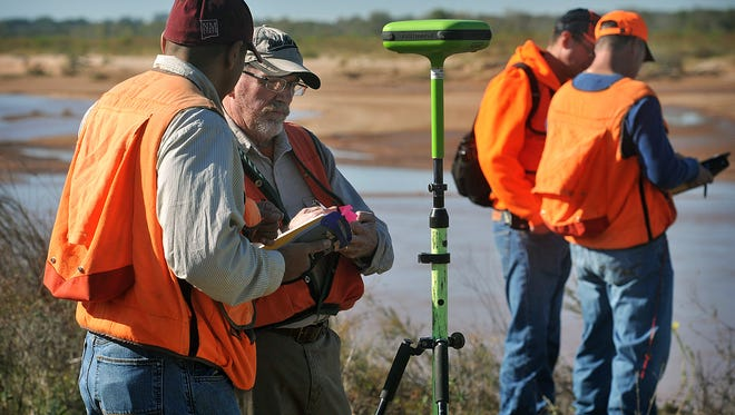 A survey crew from the Bureau of Land Management begins their work in November 2016 on Kevin Hunter's land in far northeastern Wichita County at the Red River.