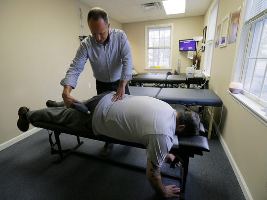 Tom Gustafson, a chiropractor who owns Active Healing