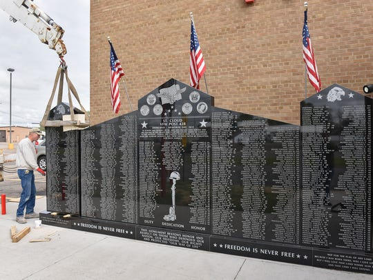 The third panel of the veterans monument is put into