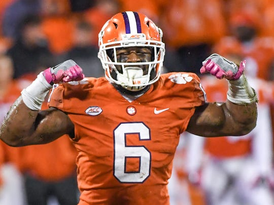 Clemson linebacker Dorian O'Daniel (6) flexes after