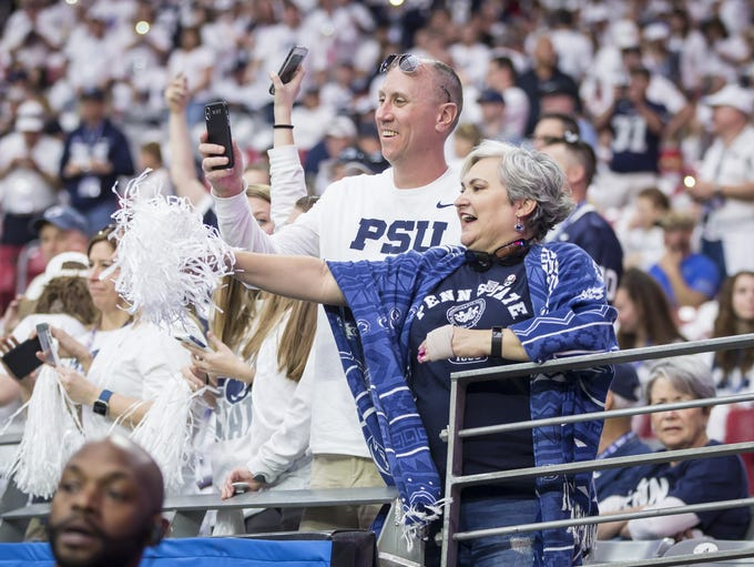 Penn State fans Bill Torr and Kelly Desimone cheer
