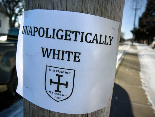 A sign is posted to a pole along West Ash Street Wednesday,