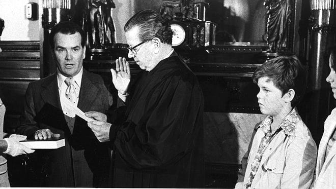 Former Parsippany-Troy Hills Mayor Henry Luther is sworn in as executive director of the New Jersey Lottery in 1975, with his family by his side. That's future and now-former Parsippany Mayor Michael Luther to the judge's left.