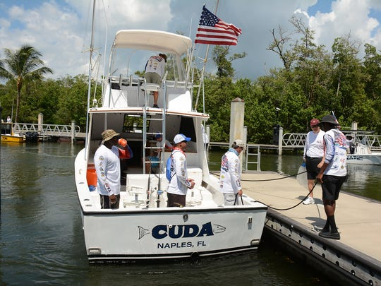 The crew of Cuda returns to the dock with their catch. Headquartered at Hamilton Harbor Yacht Club for the first year, Take a Soldier Fishing returned to Naples to give 146 active duty servicemen and women the chance to enjoy a day of fishing, thanks to local captains.