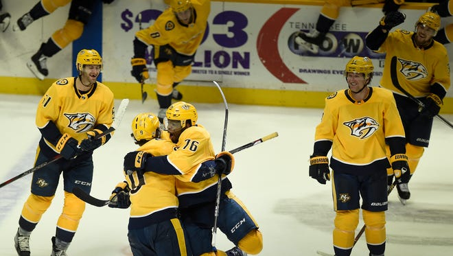 Predators left wing Filip Forsberg (9) is congratulated by defenseman P.K. Subban (76) after Forsberg scored on a penalty shot during an overtime period to win over the Blues 4 to 3 at Bridgestone Arena Tuesday, Feb. 13, 2018 in Nashville, Tenn.