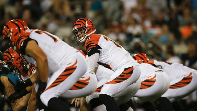 Bengals quarterback Andy Dalton has to find a quick rhythm with his new receivers against the New York Jets on Sept. 11.