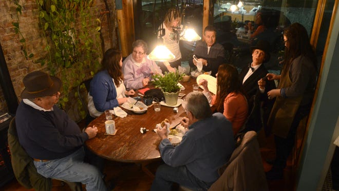 Groundhog Day revelers fill the room Monday at the Exquisite Corpse coffee house.