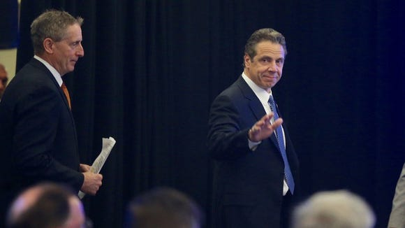 Robert Duffy, left, with Gov. Andrew Cuomo at Eastman Business Park Wednesday, March 16, 2016.