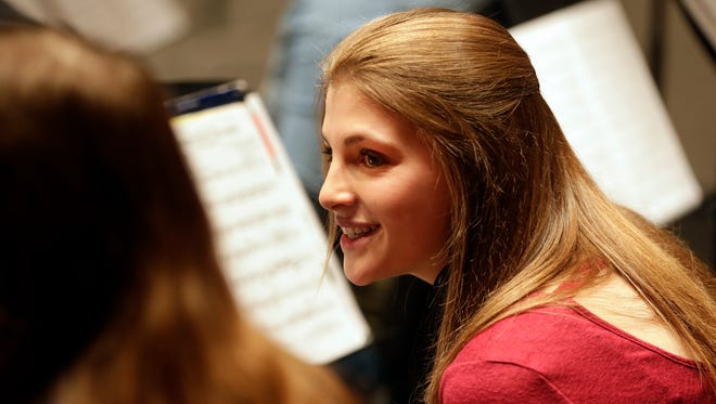 Academc Team member Brittany Russell of Oconto Falls HIgh School smiles with a friend during orchestra rehearsal at the school.