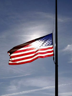 U.S. flags are being lowered to half-staff within the State Capitol Complex and on all state buildings in honor of a Michigan Department of Natural Resources conservation officer who died in a small plane crash.