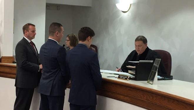 Brandon Day, right, pleads guilty to misdemeanor assault in Dickinson Town Court. He's joined by his lawyer, Chris Brown, center. District Attorney Steve Cornwell, left, prosecuted at the court appearance.