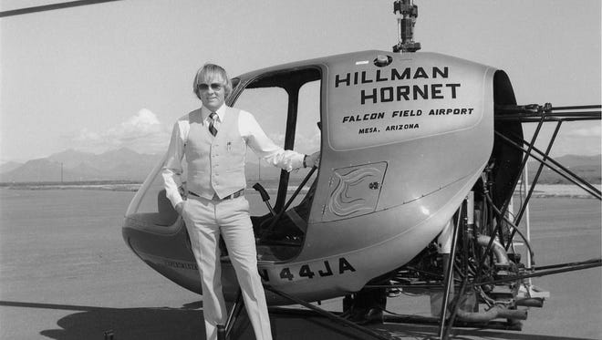 Shortly after moving his operations from Paso Robles, California, to Mesa in 1978, amateur airplane designer Doug Hillman proudly posed next to a prototype of his Hillman Hornet personal kit helicopter.