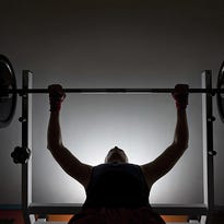 Researchers have found that weightlifting helps fight belly fat more than running.