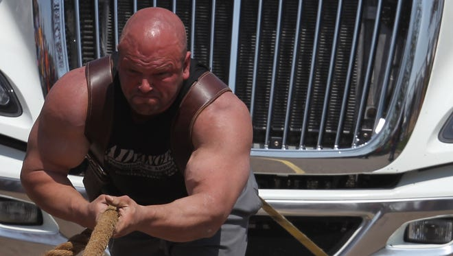 With the help of his girl friend and some rock-climbing shoes Chili strong man and dairy farmer Carl Foemmel pulled a 40,000-pound tractor trailer 100 feet for charity in Spencer, Saturday, May 2, 2015.