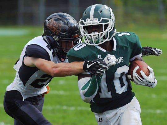 Spackenkill's Nasir Milligan, right, tries to take