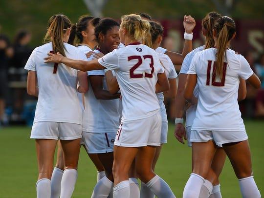 Junior Kaycie Tillman celebrates her goal with teammates