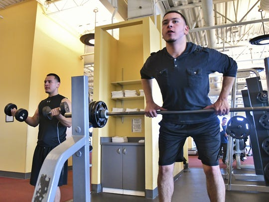 Daniel Lopez and Juan Lopez were ready to pump iron at Evolutions Fitness and Wellness Center Saturday morning.