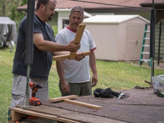 Travis Coy, left, and Steve Ellis work on the Rat Raft for Saturday's Up the Creek Raft Regatta.