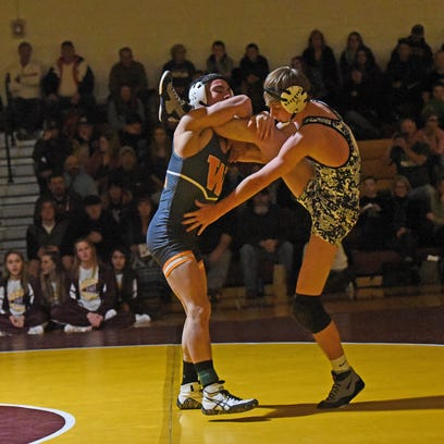 Matteo Ambriz scores a takedown in his match against