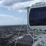 A technical crew with the Orlando Eye Ferris wheel work to evacuate passengers after it stopped July 3, 2015.