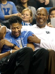 Kentucky's Kenny Payne jokes around with former Cats and current NBA star Anthony Davis.  Oct. 16, 2015
